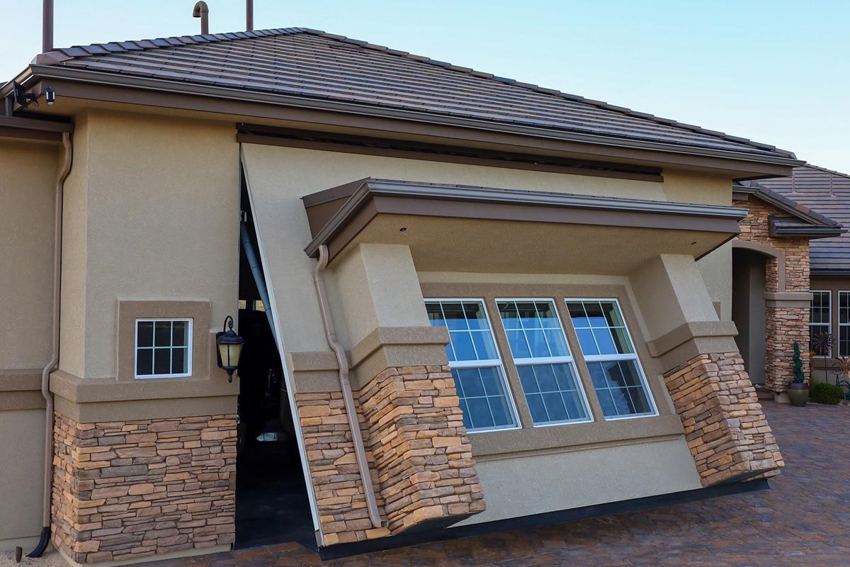 PowerLift Door: Brick Siding, Windows, And Porch