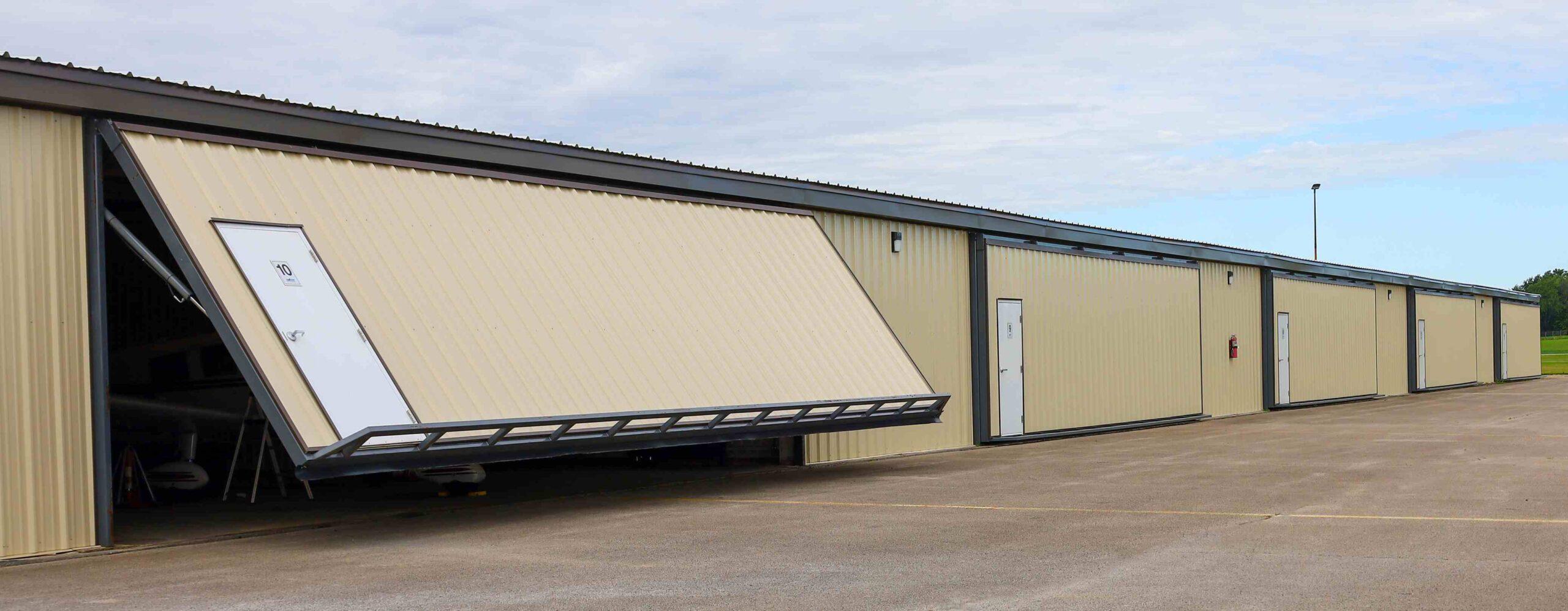 Ten old sliding hangar doors replaced with PowerLifts.