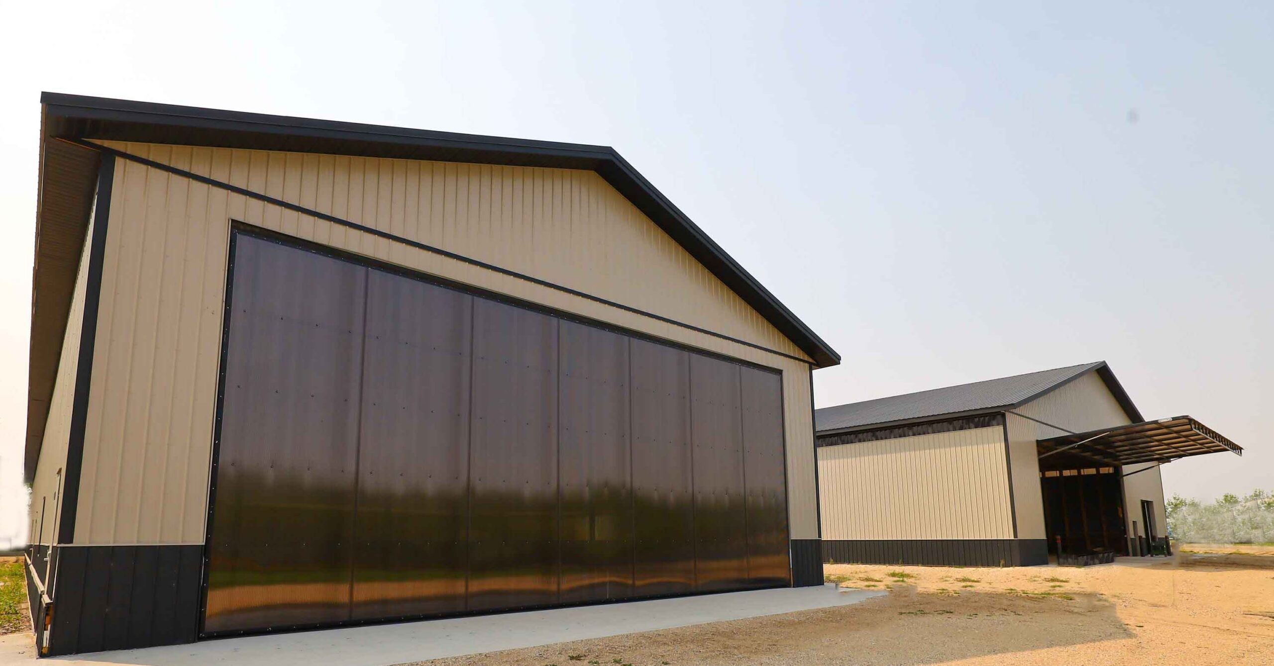 Hangar and machine storage buildings, 4 PowerLift doors.