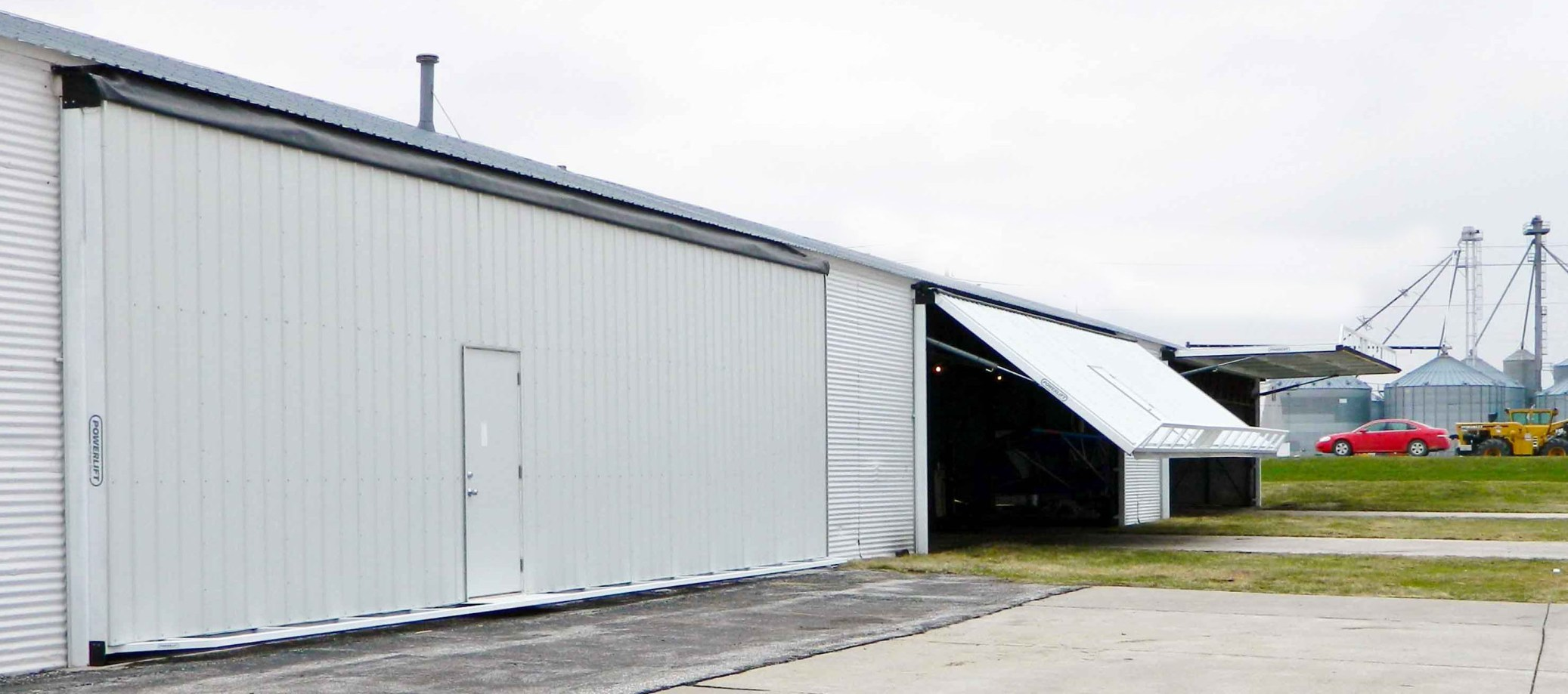 Six retrofit hangar doors replacing old bifolds.